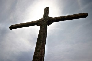>at the foot of the cross