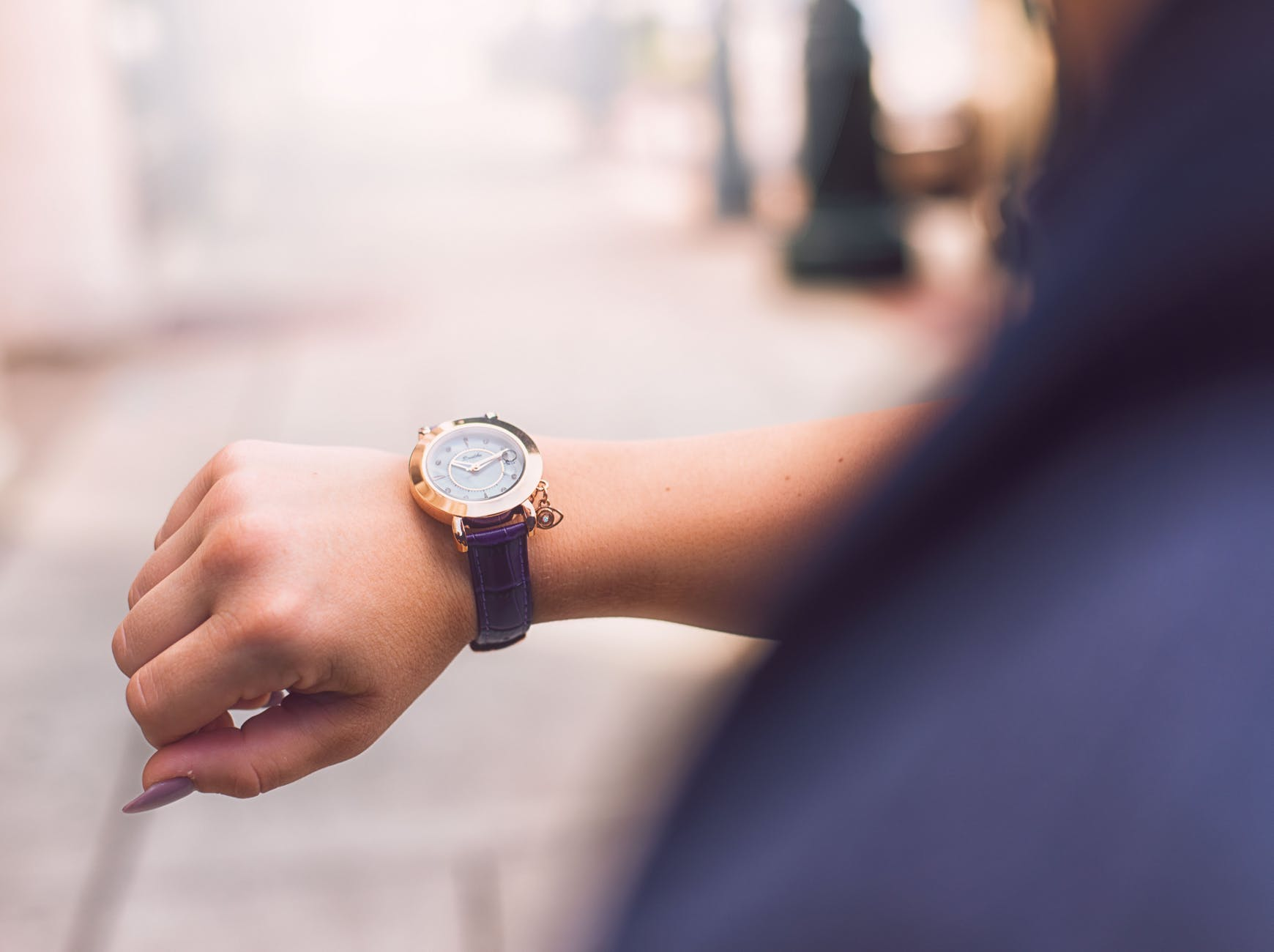 person wearing leather wrist watch